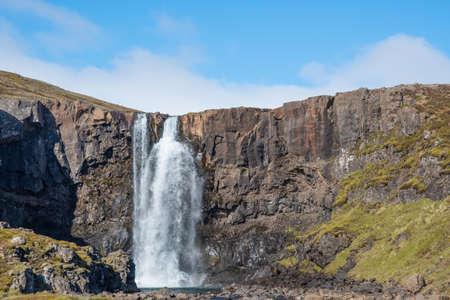 Waterfall gufufoss in river Fjardara in Seydisfjordur in east Iceland on a summer day