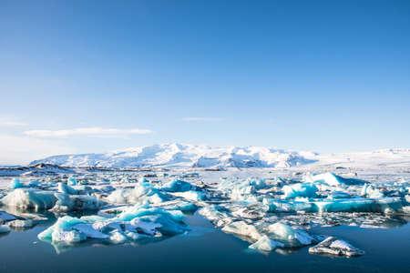 Icebergs in Jokulsarlon Glacier Lagoon in south Iceland with Vatnajokull glacier in the background