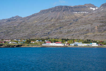 View over town of Breiddalsvik in east Iceland on a sunny summer day Stock Photo