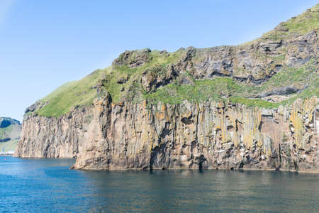 Cliffs of island of Heimaey in Vetmannaeyjar island group of the south coast of Iceland