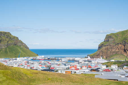 View over town of Heimaey in Iceland on a sunny summer day