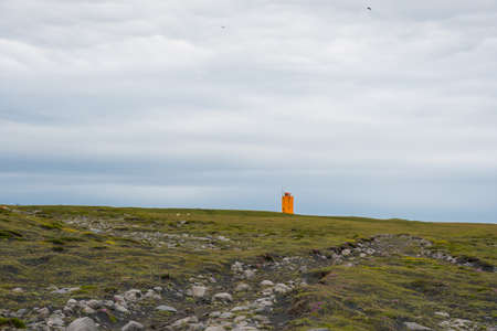 The lighthouse on Ingolfshofdi cape in south Iceland