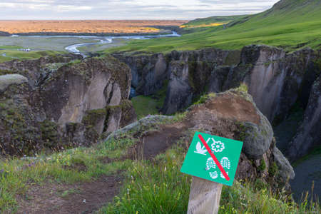 Sign telling that it is forbidden to walk further due to nature protection at Fjadrargljufur in south Iceland