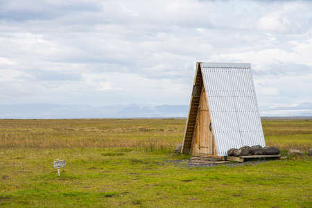 Toilet in the middle of the rural Icelandic countryside Stock Photo