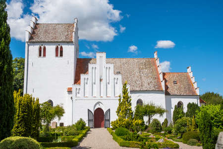 Alsted church in Denmark on a sunny summer day