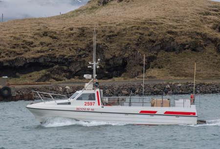 Hornafjordur Iceland - May 2. 2019: High speed fishing vessel Benni entering port Editorial