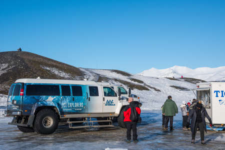 Jokulsarlon Iceland - February 17. 2019: people in front of glacier truck from Ice Explorers Editorial