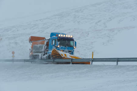 Skjoldolfsstadir Iceland - February 9. 2019: A Lorry with a snowplow plowing snow in Jokuldalur in East Iceland Editorial