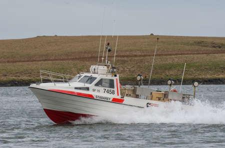 Hornafjordur Iceland - May 2. 2019: High speed fishing vessel Stadarey entering port