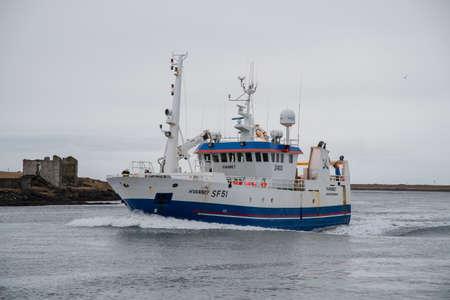 Hornafjordur Iceland - January 12. 2019:Fishing Vessel Hvanney entering port of Hornafjordur Editorial