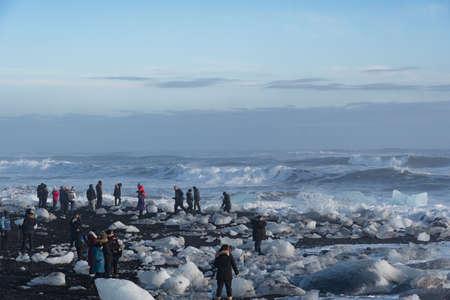 Jokulsarlon Iceland - February 17. 2019: Tourists among the breidamerkursandur beach, often called Diamond beach