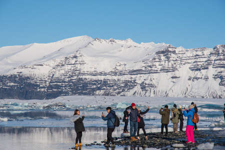 Jokulsarlon Iceland - February 17. 2019: Tourists having a fun day at the jokulsarlon glacier lagoon tourist destination Editorial
