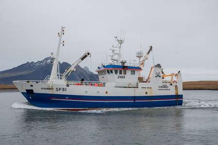 Hornafjordur Iceland - January 12. 2019: Fishing Vessel Hvanney entering port of Hornafjordur Editorial