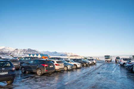 Jokulsarlon Iceland - February 17. 2019: cars parked at the parking lot at Jokulsarlon glacier lagoon