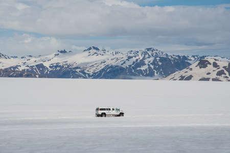 Vatnajokull Iceland - June 17. 2019: Modified 4x4 minibus driving with tourists on Skalafellsjokull Glacier, a part of Vatnajokull glacier and national park