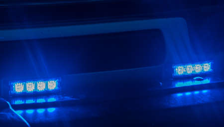 Blue blinking lights of an emergency vehicle