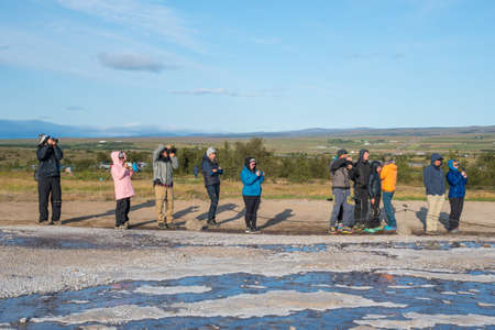 Geysir Iceland - August 10. 2019: Tourists waiting to see geyser Strokkur erupt