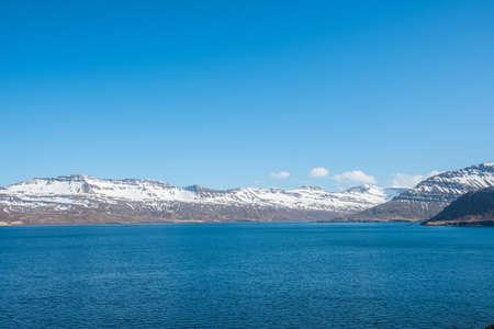 the mountainous coastline of Nordfjordur in east Iceland
