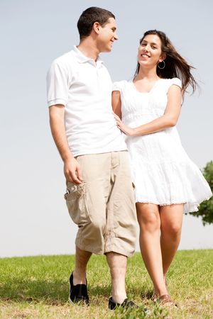 togther: young love couple walk togther and smiling Stock Photo