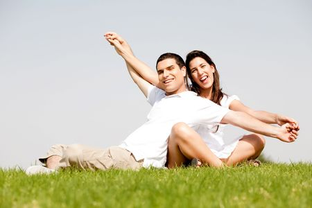 Cute young couple in a hands outstretched Stock Photo - 5900169