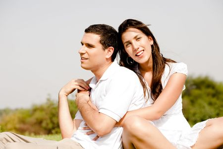 love Couple Sitting Together Outside and Hugging  Stock Photo - 5900174