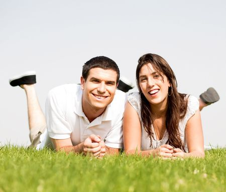 love Couple lie down on grass Together Outside and smile Stock Photo - 5900199