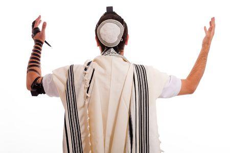 jewish prayer: jewish men put phylactery on isolated background