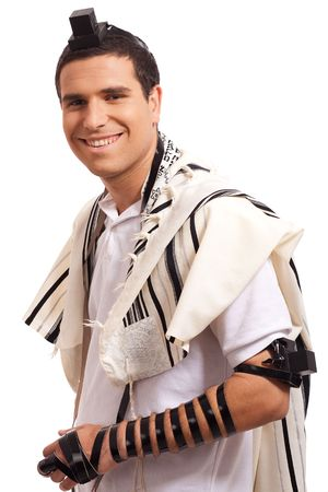 tefillin: jewish men put phylactery on isolated background