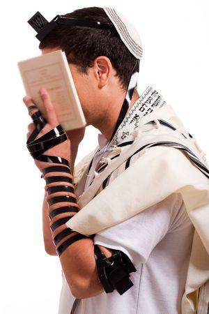 jewish prayer: jewish men praying on isolated background
