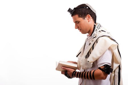 Side view of young  jewish man with book on white isolated background photo