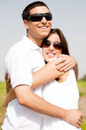 Portrait of Romantic couple hugging passionately at the park,outdoor photo