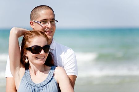 passionately: happy Young couple holding passionately at the beach half length Stock Photo