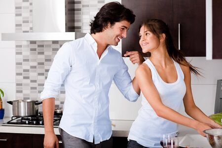 Beautiful young couple in the kitchen photo