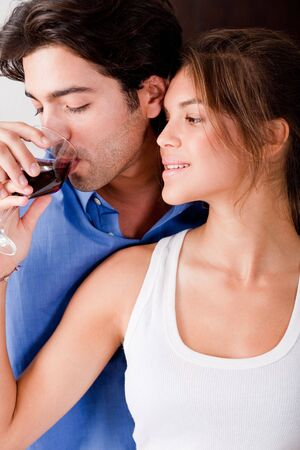 honeymoon couple drinking wine in kitchen photo