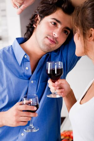 man looking his wife with wine and enjoying his moment photo