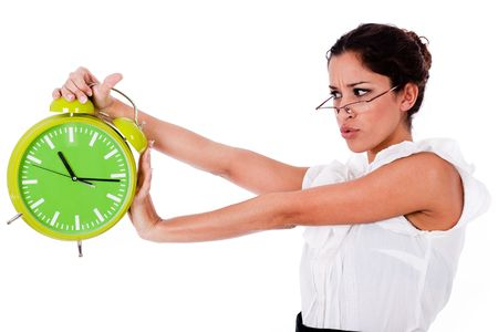 Shot of a Young business woman holding clock on isolated white background photo