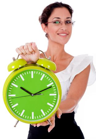 time pressure: Young business womanshowing a green color clock on isolated white background Stock Photo