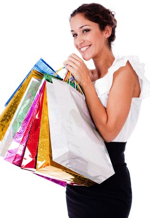portrait of pretty young women smiling with shopping bag on white isolated background photo