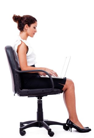 Portrait of a woman working with laptop by sitting in the wheel chair photo