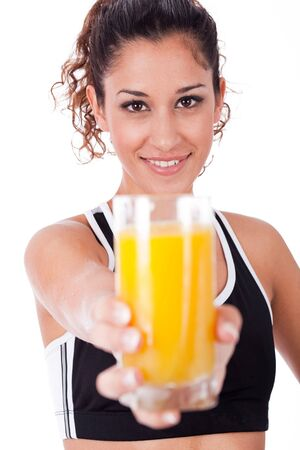 fitness girl showing a fresh juice,focus on girl on a white isolated background photo