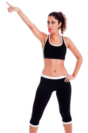 Young fitness woman pointing up the right corner on isolated white background photo