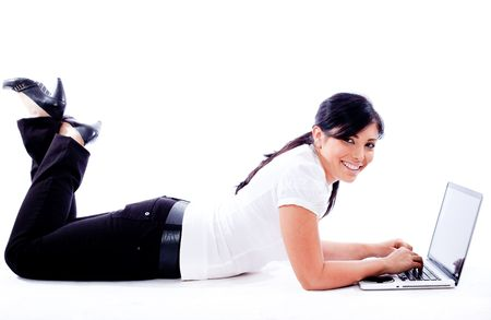 Business woman lying with laptop on white isolated background Stock Photo - 6085900