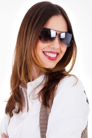 Young brunette model smiling with sunglasses on a white background photo
