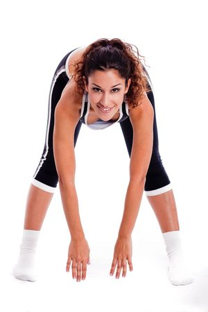 bending down: Women bending down and doing her excercise on white background Stock Photo