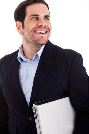 Young worker carrying a laptop with a broad smile on a white background photo