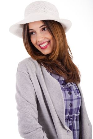 Young model with spring clothing and white hat on a white isolated background Stock Photo - 6079325