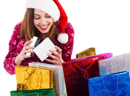 Santa girl opening the gift box on a white background photo