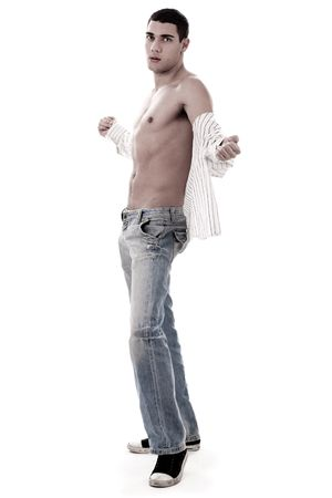 torso only: Trendy model show his muscles in jean over white background