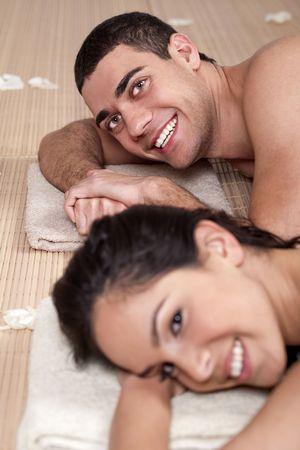 Closeup portrait of a romantic couple on a spa holiday photo