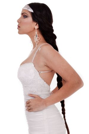 Side pose of Bride with long and lengthy platted hair in isolated white background photo